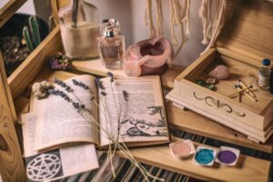 books, herbs and crystals adorn a relaxing therapy room